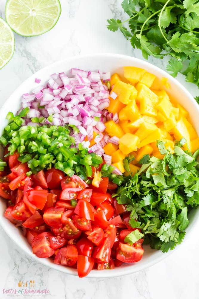 Bowl of ingredients used in making mango salsa