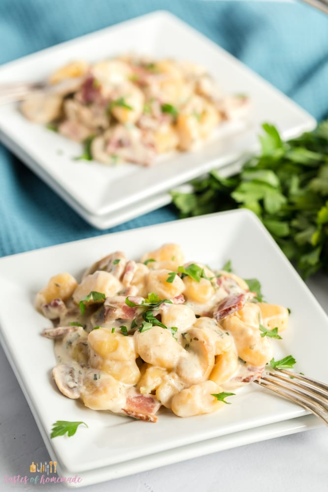 Gnocchi tossed in a creamy, cheese sauce with bacon and mushrooms.