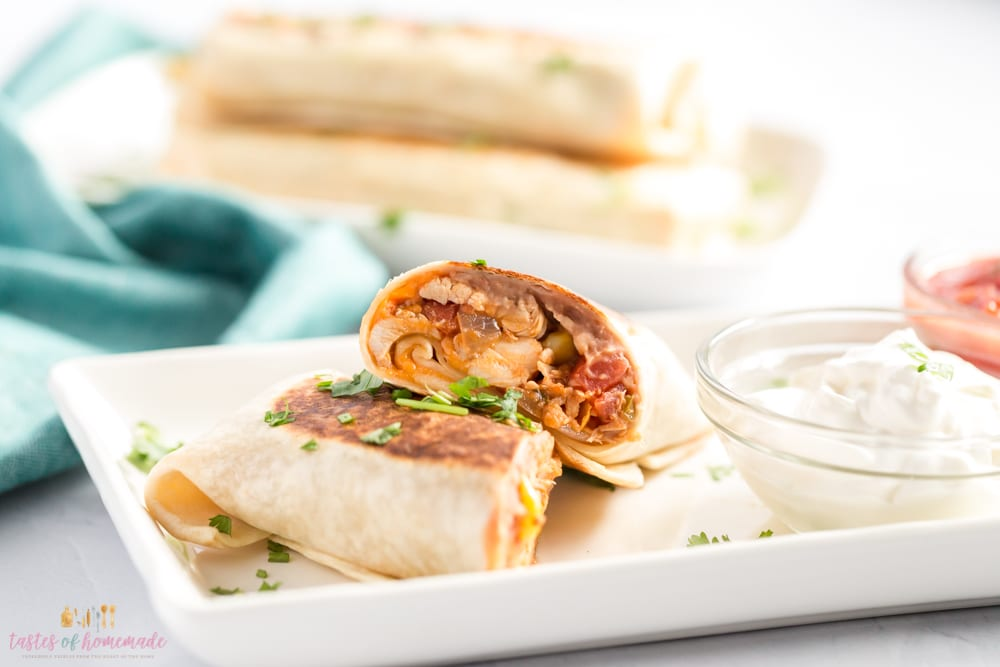 Burrito cut in half on a plate