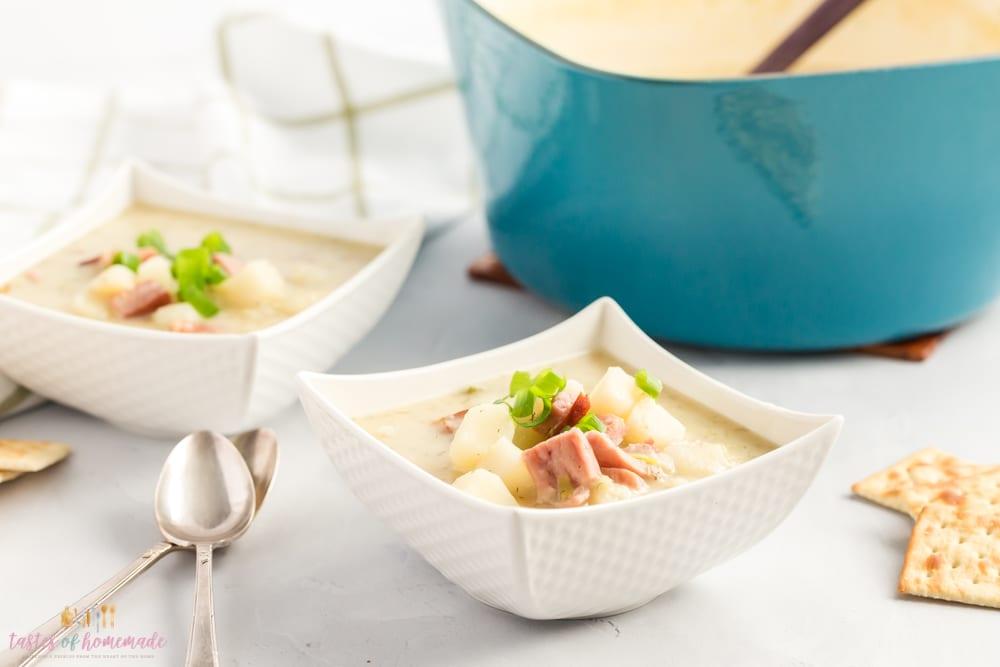 Bowls of potato soup on a table