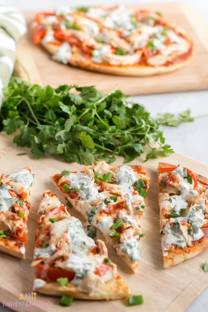 Butter chicken pizza on a cutting board