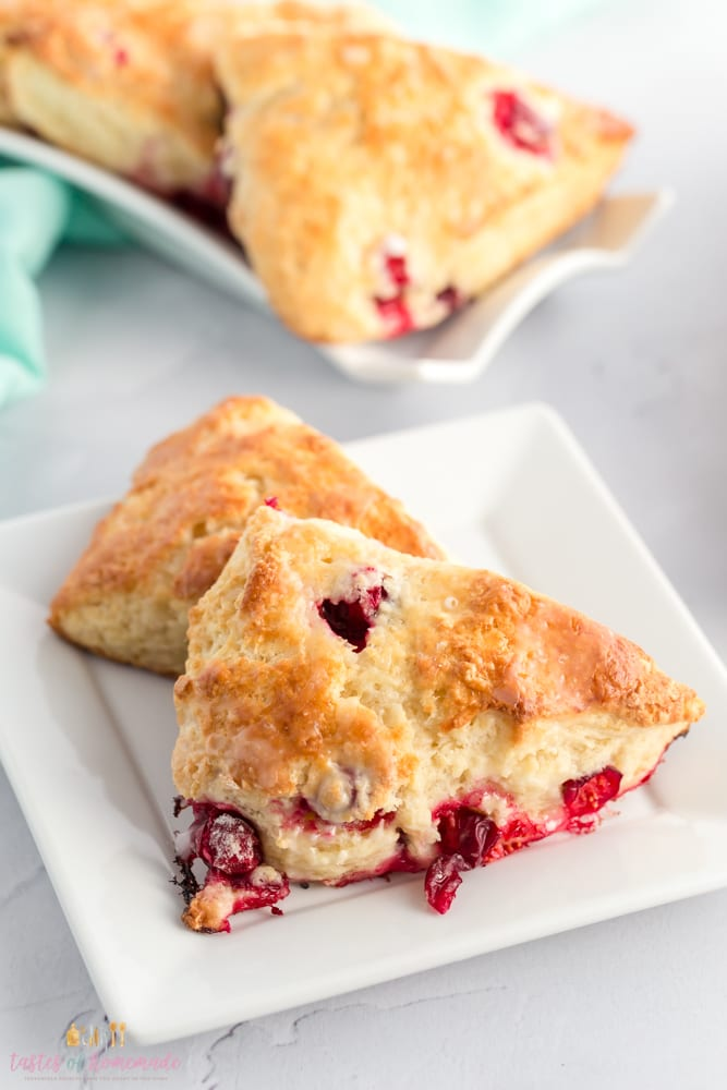 Cranberry scones on a square plate.