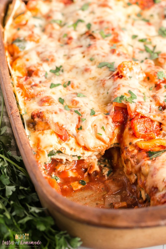 Tray of lasagna with a slice cut out