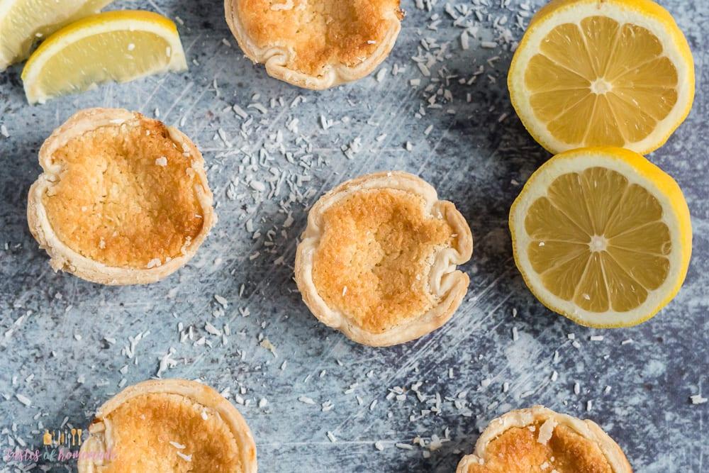 Lemon tarts and lemons on a table