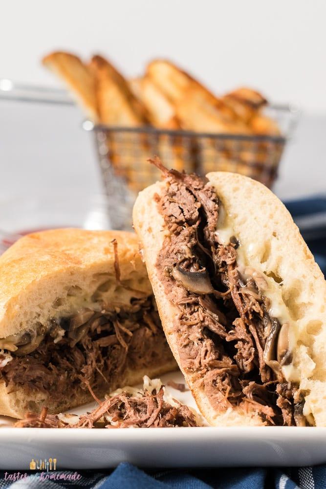 A shredded beef sandwich on a plate.