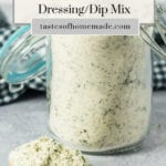 Ranch dip mix in a jar with a spoon of mix on the table