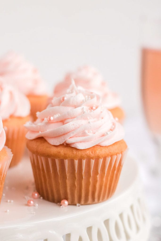 Pink cupcake on a cake stand