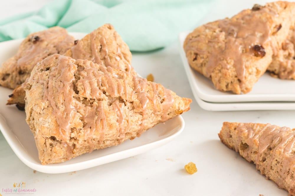 Cinnamon raisin scones on white plates.