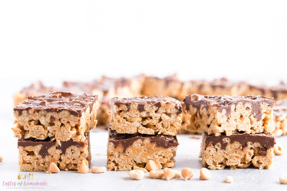 A row of 6 caramel oat squares with butterscotch chips scattered around.