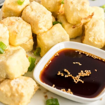 tofu nuggets served with soy sauce