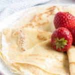 Folded crepes and strawberries.