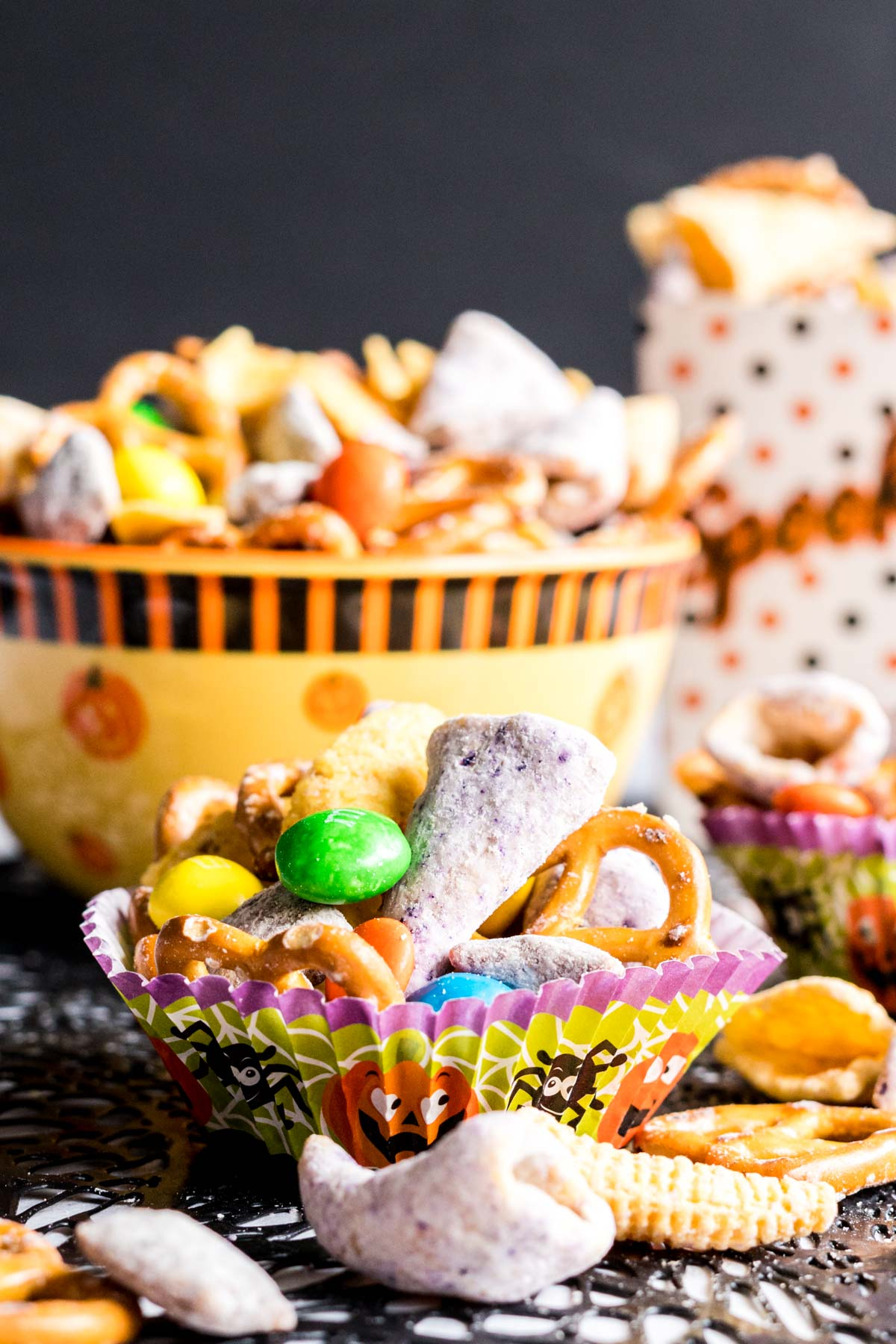 Single serving of snack mix in a paper muffin liner.