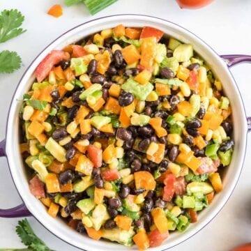 Black bean corn salsa in a purple serving dish.