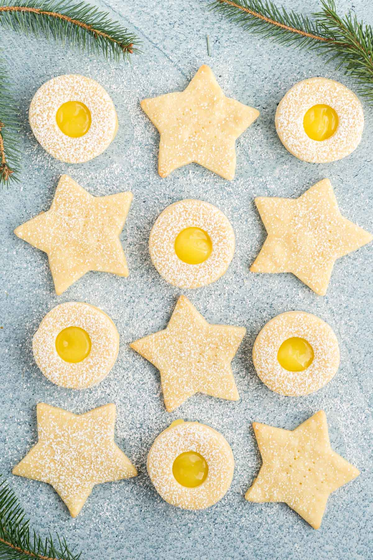 Overhead of round and star shaped lemon shortbread cookies.