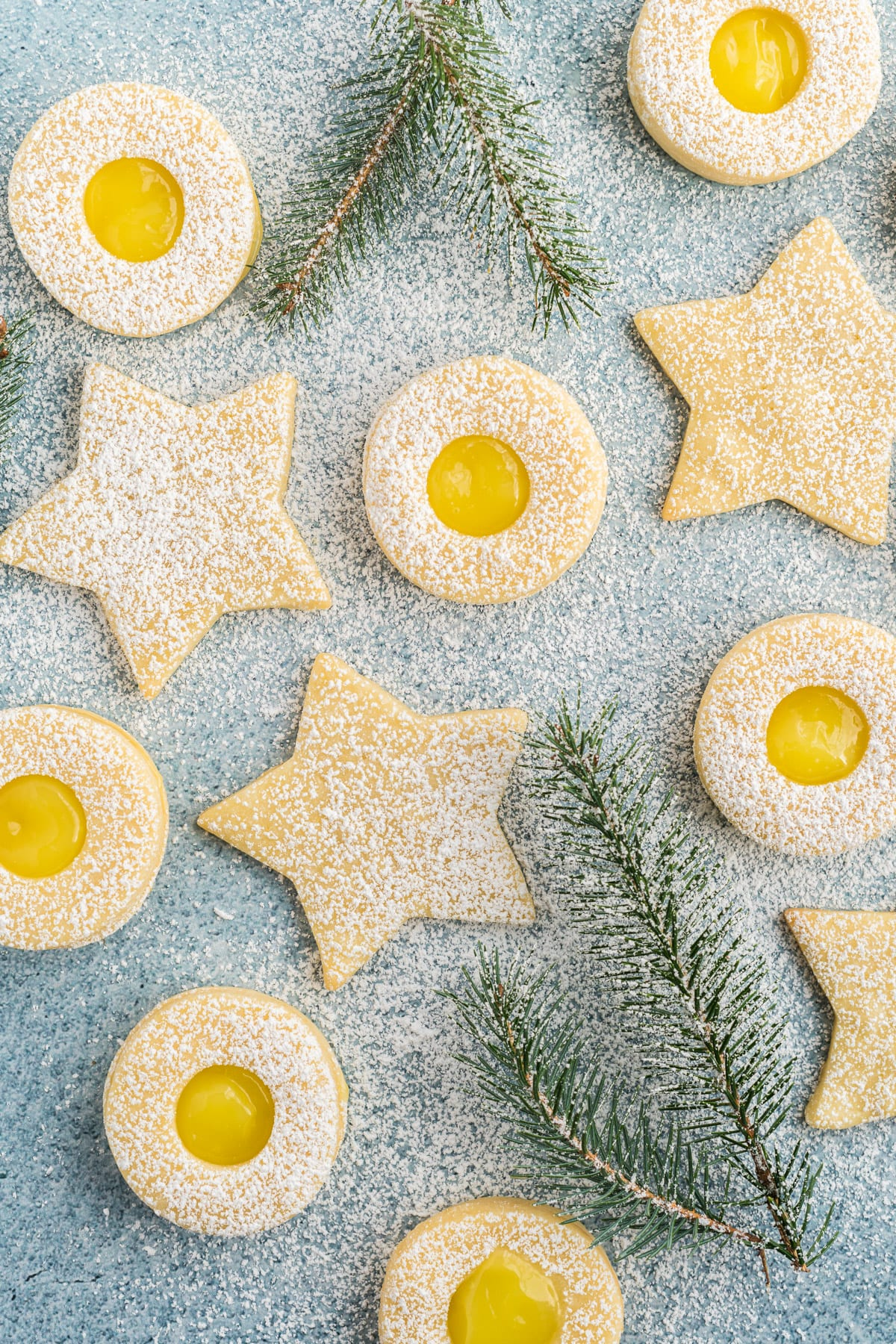 Shortbread cookies cut like stars and shortbread filled with lemon curd.