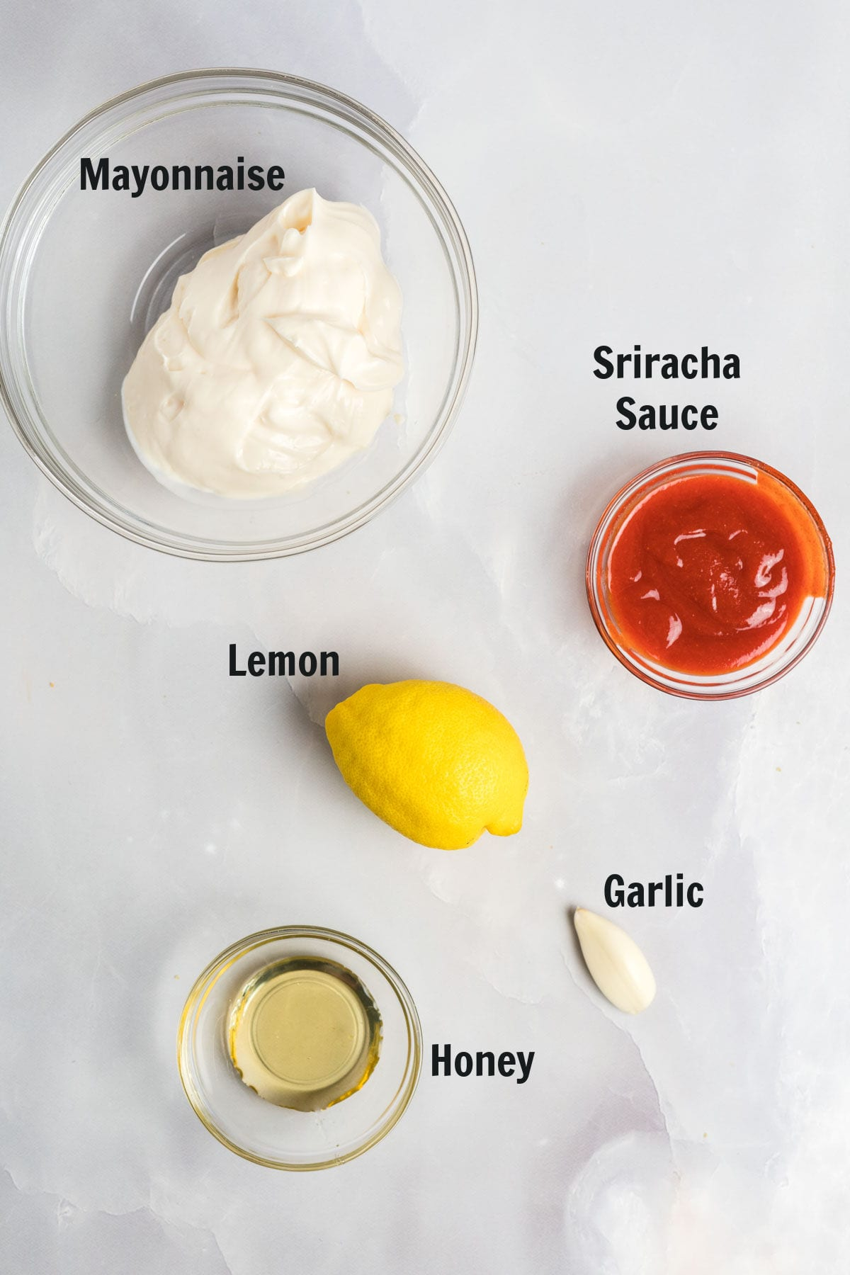 Ingredients to make spicy mayo.