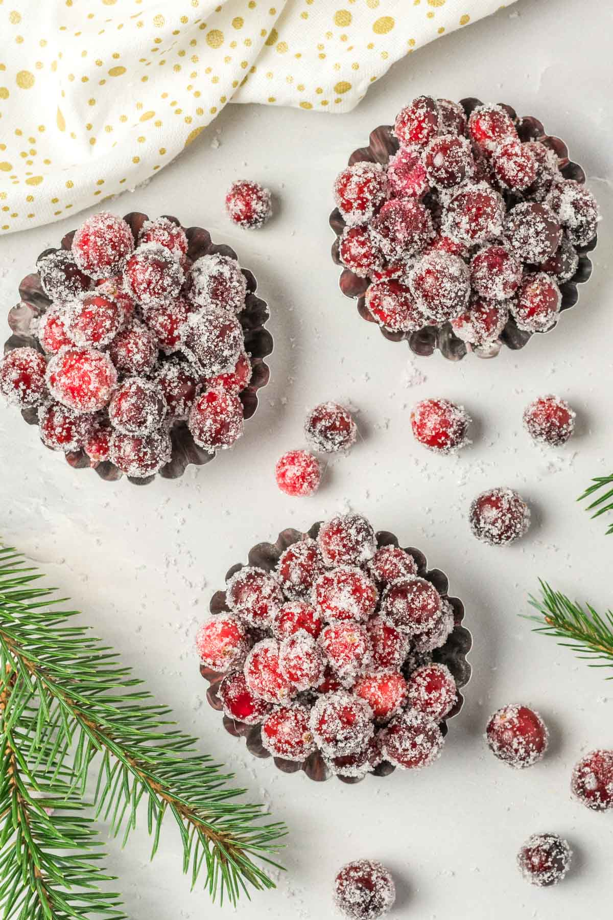 Candied cranberries in small tart tins.
