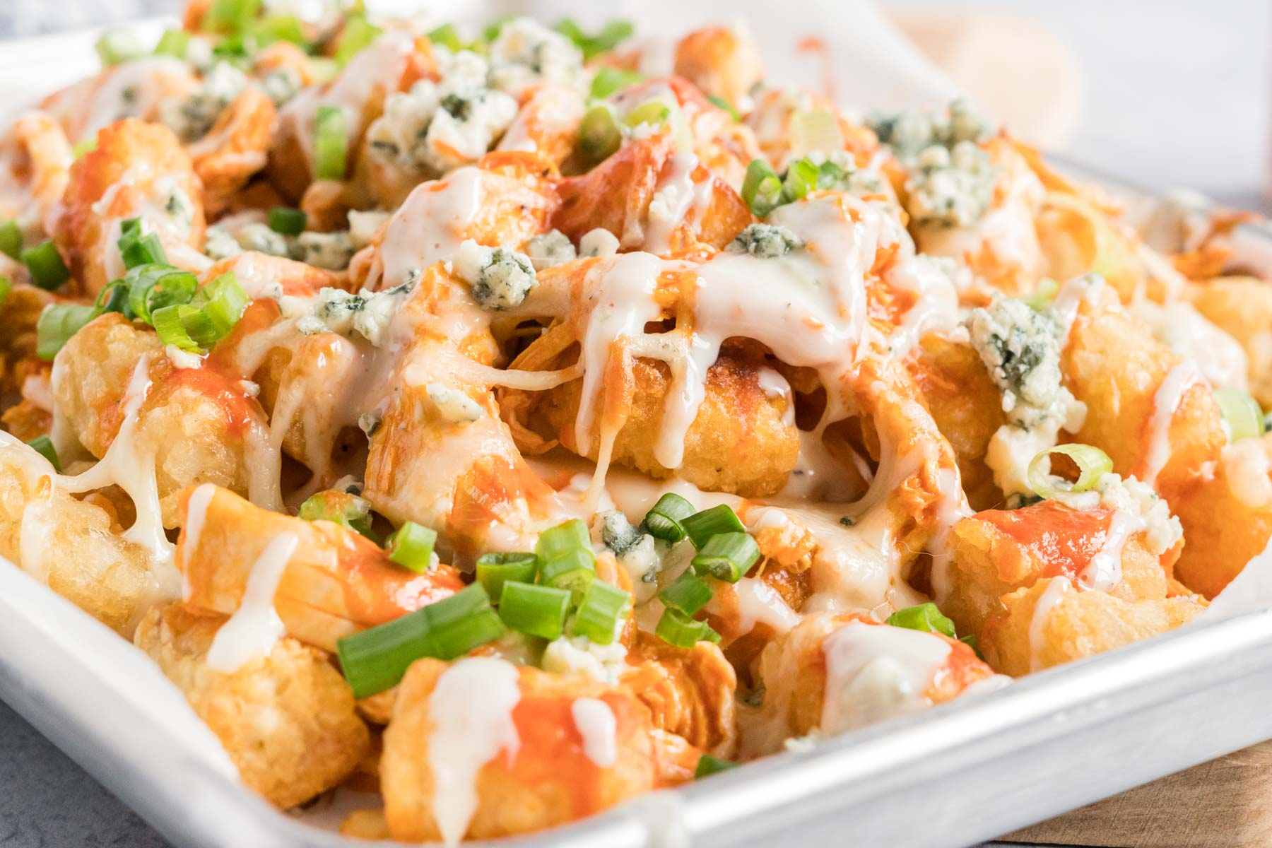 Tater tots with buffalo chicken, cheese and blue cheese dressing.