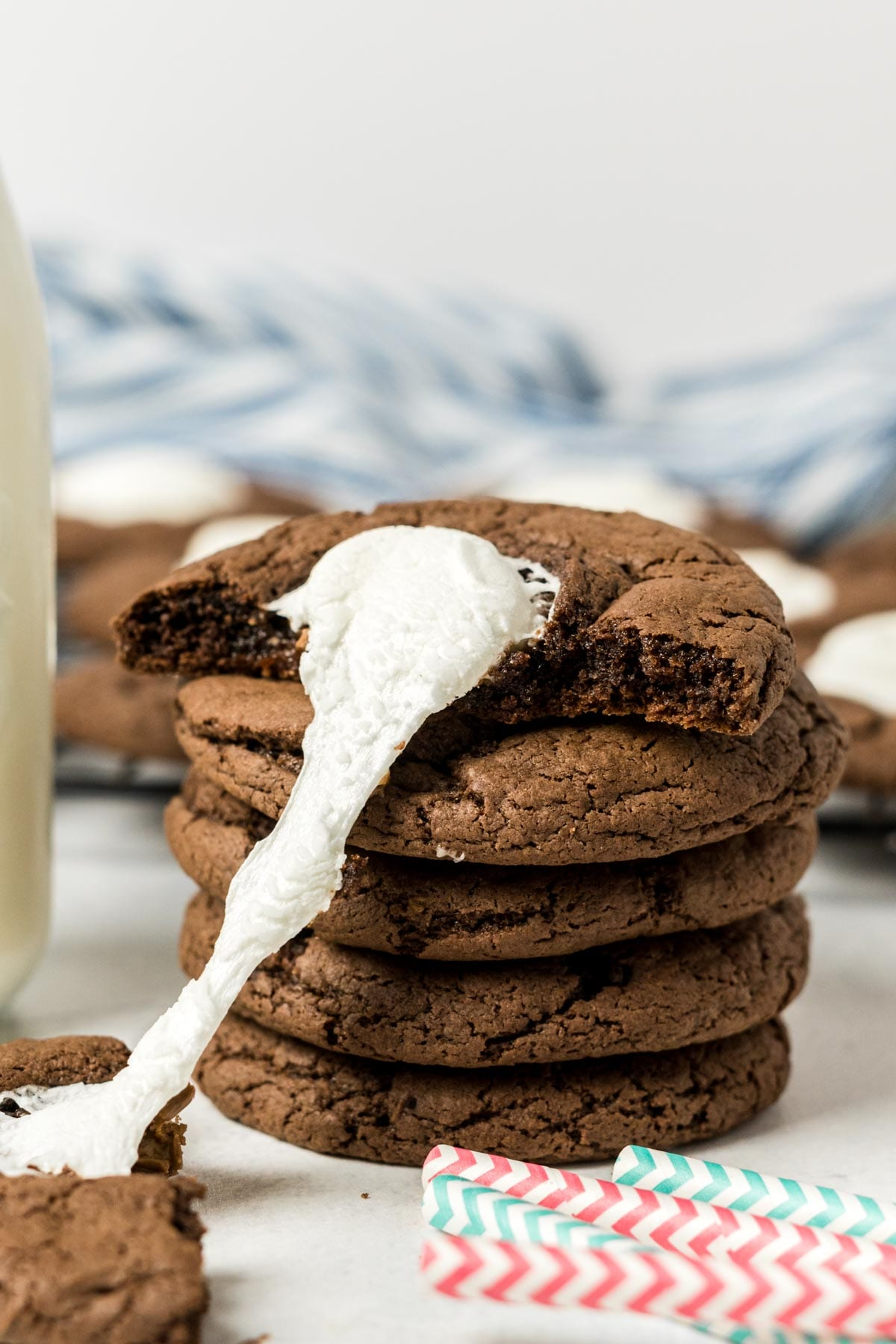 Stack of cookies with melted marshmallow.