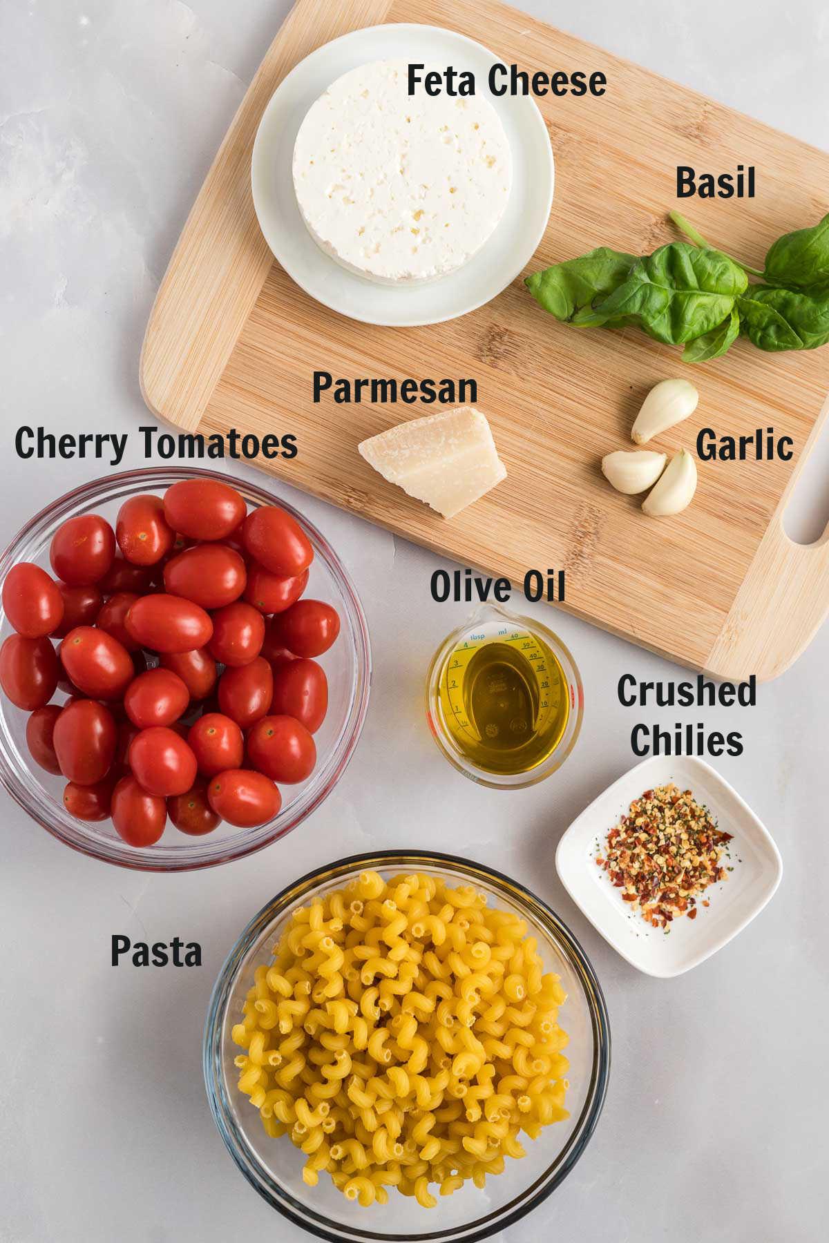 Ingredients to make tomato feta pasta.