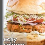 Salmon burger topped with tomato, sprouts and onion.