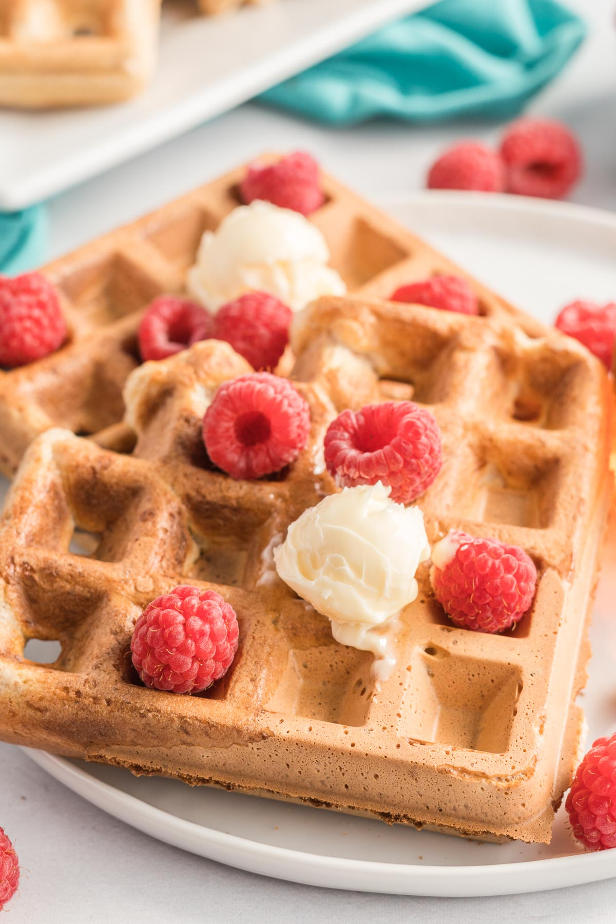 Waffles with butter and raspberries.